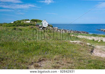 Coastal landscape and fisherman's house
