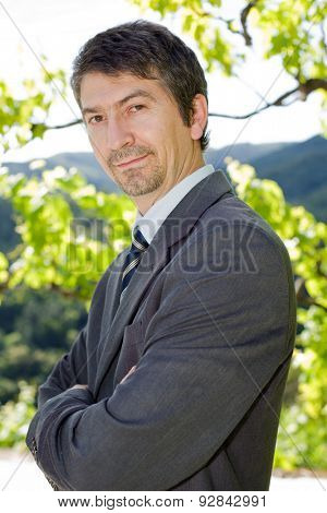 portrait of a happy young businessman, outdoors