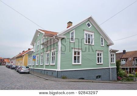 Green wooden home in central town