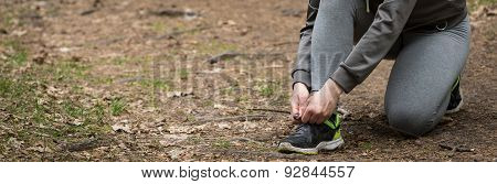 Female Hands Tying Shoes