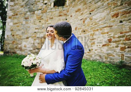 Young Wedding Couple In Love On Their Wedding Day
