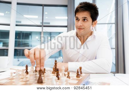 Two businessmen with chess in office