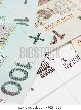 Closeup Of Money With Receipt On White Background