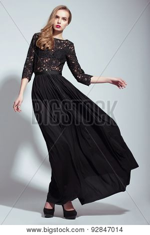 Elegance. Young Fashion Model In Black Dress