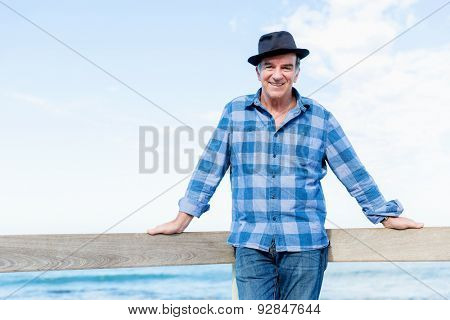 Portrait of an od man next to ocean