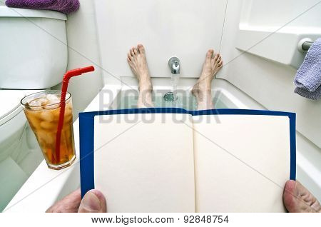 Hands Holding Blank Book In Tub