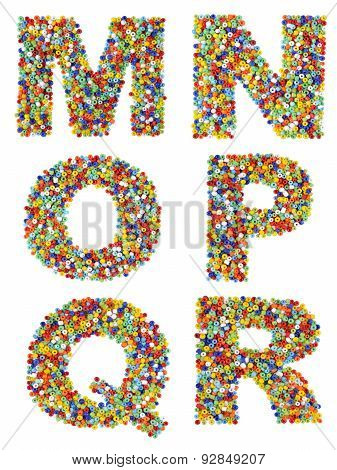 Letters Of The Alphabet M Through R Made From Colorful Glass Beads On A White