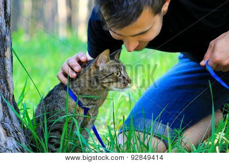 cat on a leash with owner
