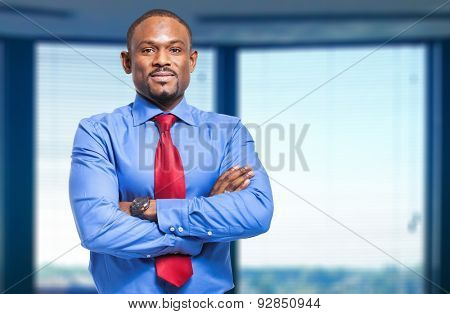 Smiling black businessman in the office