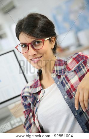 Portrait of office worker with eyeglasses on