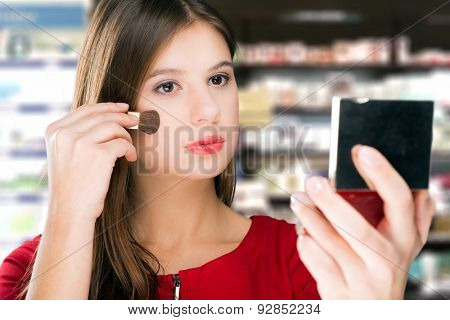 Woman trying a product in a beauty shop