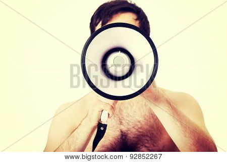 Handsome shirtless man shouting using a megaphone.
