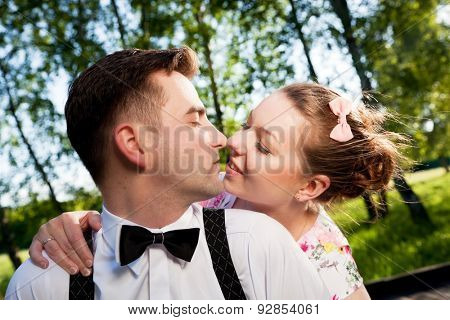 Young romantic couple flirting in summer park. Dating, love, romance