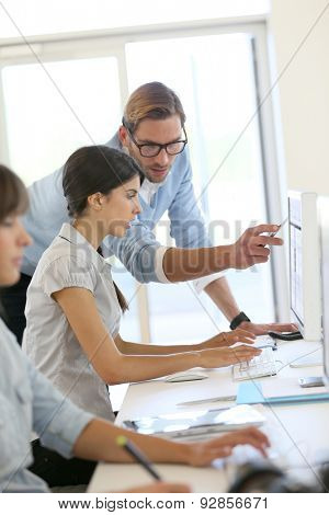 Creative people working in office on computer