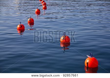 Red numbered buoys