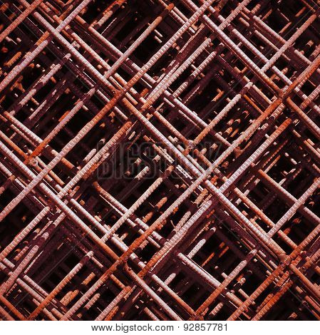 Stack of rusty rebar grids at the construction site