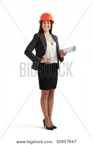 smiley woman architect in orange hardhat holding plan and looking at camera. isolated on white background