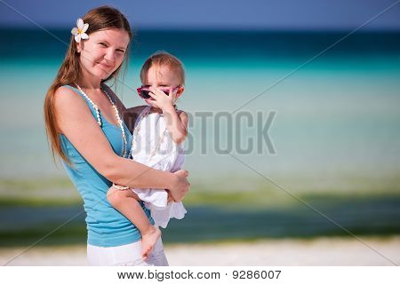 Young Mother Holding Baby Daughter