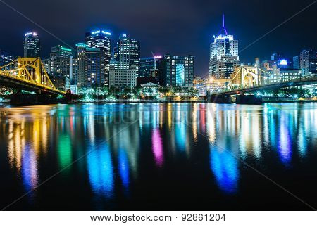 The Pittsburgh Skyline Reflecting In The Allegheny River At Night, Seen From The North Shore, In Pit