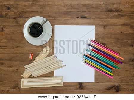 Paper sheet painting supplies and cup of coffee