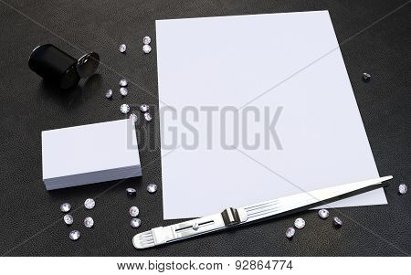 Diamonds, Jewelry Tweezer And Eye Loupe And  Business Cards