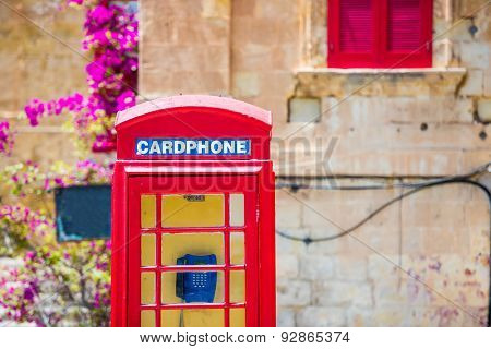 red cardphone in a steet of Valletta in Malta