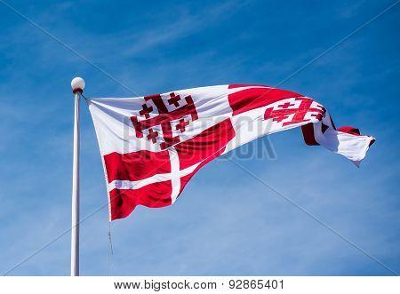 photo of maltese flag in the sky in Valletta