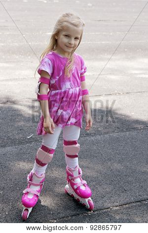 Girl In Roller Skates And Protection