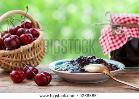 Basket With Cherry, Saucer And  Jar Of Jam.