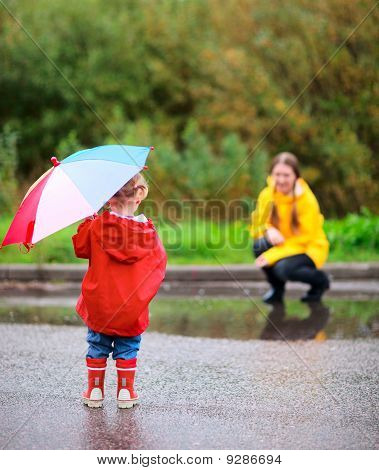 Mother And Daughter Outdoors At Rainy Day