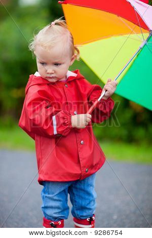 Portrait Of Toddler Girl With Umbrella