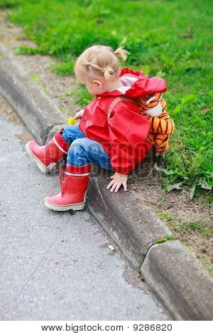 Toddler Girl Outdoor At Rainy Day