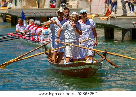 Oarsmens in the Venice Vogalonga regatta, Italy.
