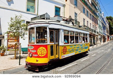 Traditional Vintage Lisbon Yellow Tram Decorated With Sardines