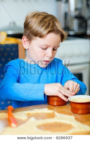 Cute Boy Making Cupcakes