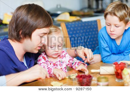 Father Baking With His Two Kids