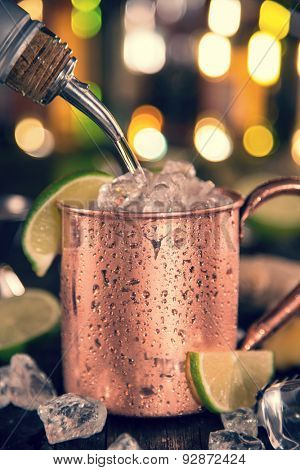 Cold Moscow Mule - Ginger Beer, lime and Vodka on bar