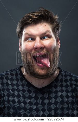 Portrait of man grimacing