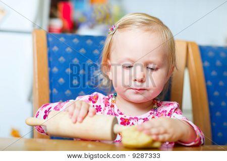 Toddler Girl Helping At Kitchen