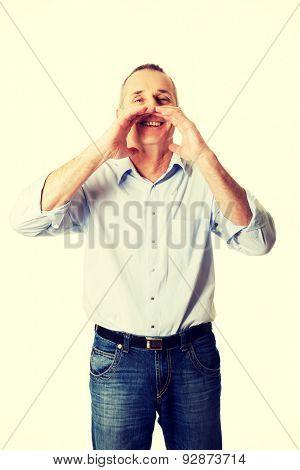 Handsome mature man calling someone
