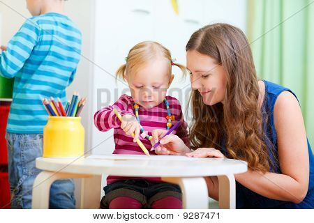 Mother Drawing Together With Her Daughter