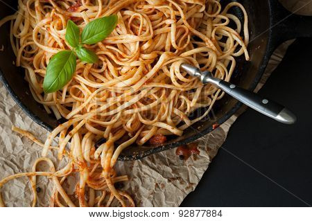 Linguine With Red Sauce And Fresh Basil In A Cast Iron Pan
