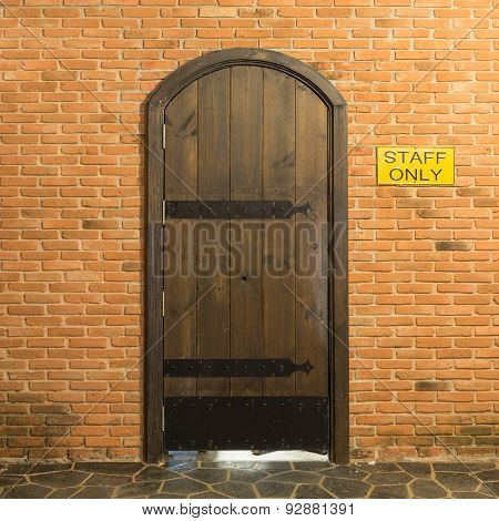 Wood Arch Door On Red Brick Wall