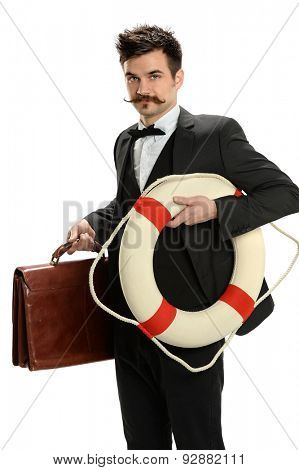 Portrait of young businessman holding suitcase and life ring isolated over white background