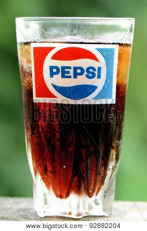 Vintage glass with old Pepsi logo in closed-up.