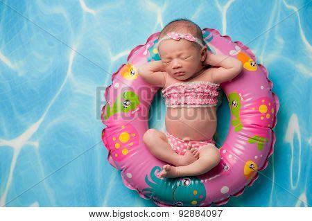 Newborn Baby Girl Wearing A Pink Polka Dot Bikini