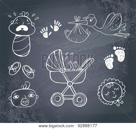Set of hand-drawn icons baby toys and accessories on a blackboard..