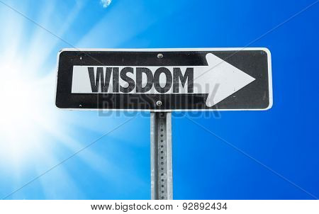 Wisdom direction sign with a beautiful day