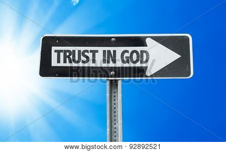Trust in God direction sign with a beautiful day