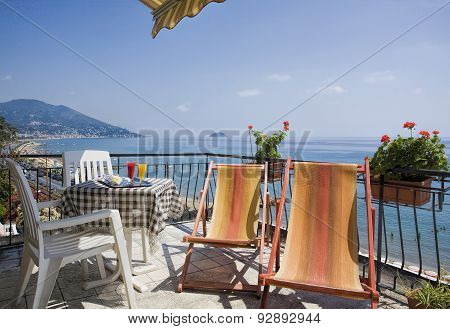 Table With Drink Above The Sea